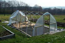 Homemade greenhouse frame with glazing almost ready for stapling